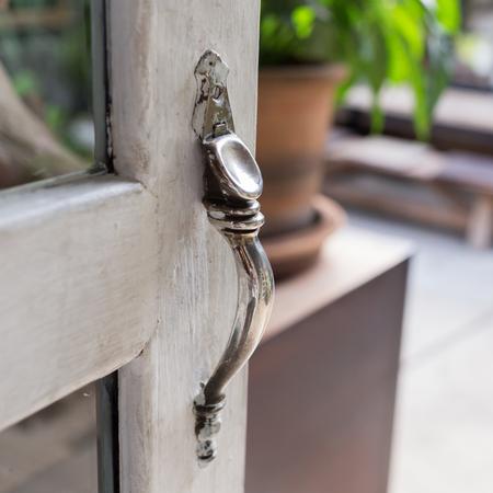 white door: open the door, close-up door handle style ancient on vintage white wooden door Stock Photo