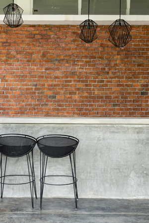 bar stool: cement counter nightclub with seat bar stool and brick wall background Stock Photo