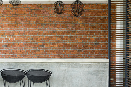 cement counter nightclub with seat bar stool and brick wall background 版權商用圖片
