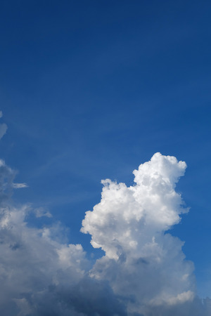 cumulus: large cumulus cloud on clear blue sky background