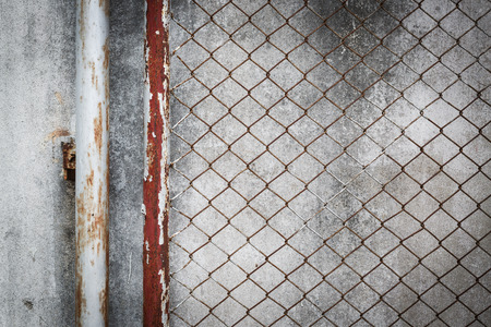 metal wall: rusty wire fence with cement wall grunge background