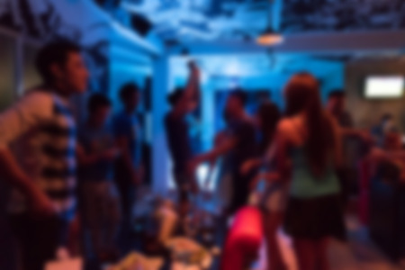 drinking drunk: image blurred background, group of young people having joyful dancing in nightclub party Stock Photo