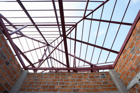 steel beam: structural steel beam on roof and brick wall of building residential construction Stock Photo