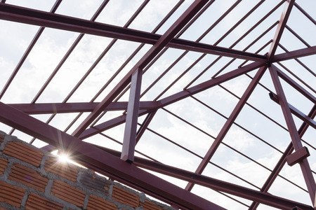structural steel beam on roof of building residential construction with sunlight