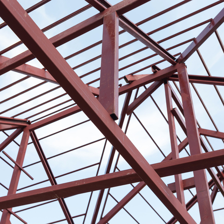 housebuilding: structural steel beam on roof of building residential construction Stock Photo