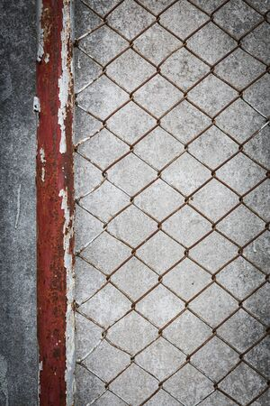 rusty wire: rusty wire fence with cement wall grunge background