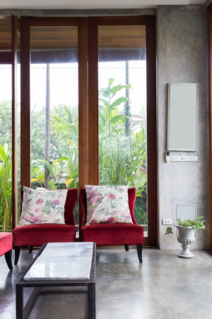 garden furniture: design of interior living room modern style with red sofa furniture in green garden