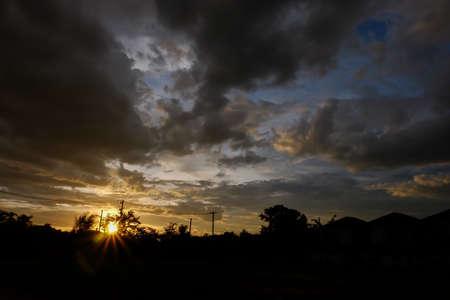 precipitation: black cloud on sunset dramatic dark sky background Stock Photo