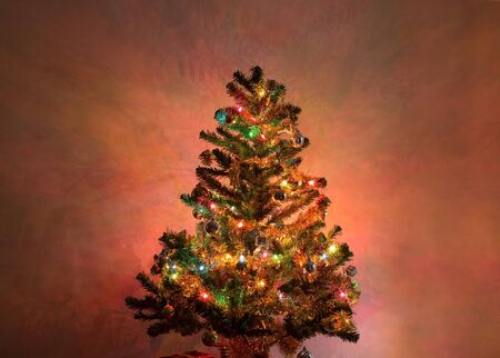 festive pine cones: christmas tree decoration with twinkling light and christmas ornament in home