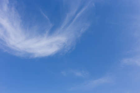 wind blowing: wind blowing cloud on clear blue sky background Stock Photo