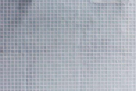 bathroom tile: gray mosaic tile wall background in bathroom