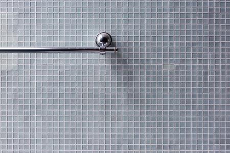 bathroom tile: bathroom, stainless steel towel rail in bathroom with mosaic tile wall background