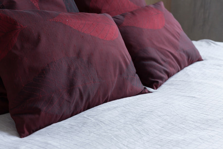 king size bed: bedroom interior design modern style with white mattress and red pillow Stock Photo
