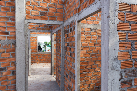 residential: structural wall made of brick in residential building construction site Stock Photo