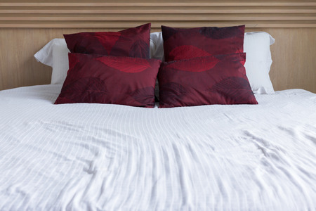 mattress: bedroom interior design modern style with white mattress and red pillow and wooden headboard Stock Photo