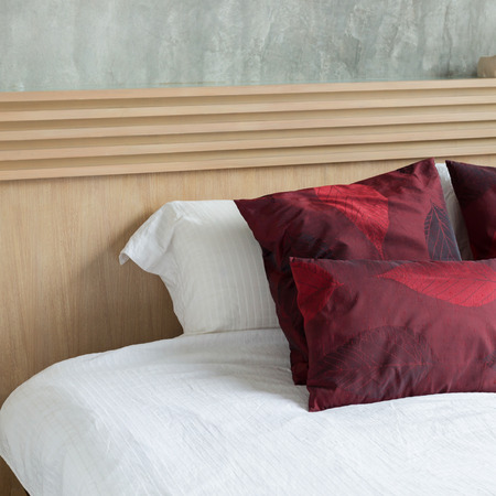 headboard: bedroom interior design modern style with white mattress and red pillow and wooden headboard Stock Photo