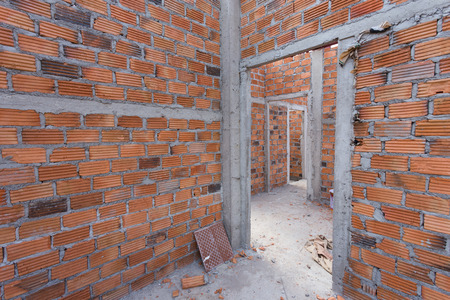 housebuilding: structural wall made of brick in residential building construction site Stock Photo