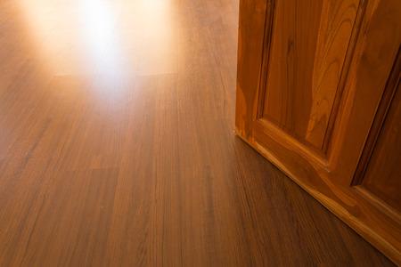 wood laminate: wood laminate floor and wooden door open
