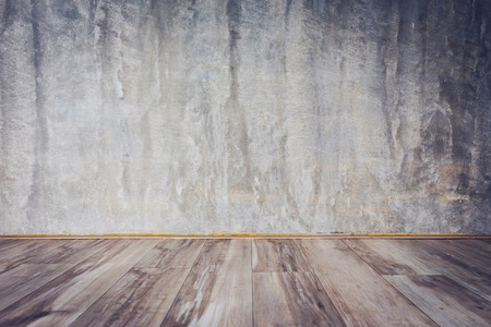 polished: cement mortar wall background and wood floor in the room