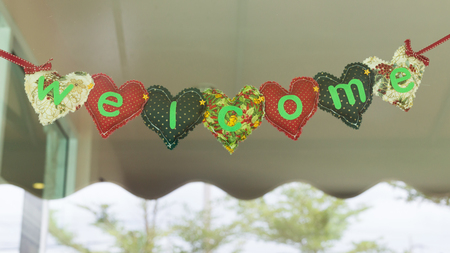 welcome message heart alphabet handmade hanging on mirror of decoration cafe coffee shop vintage style Stock Photo