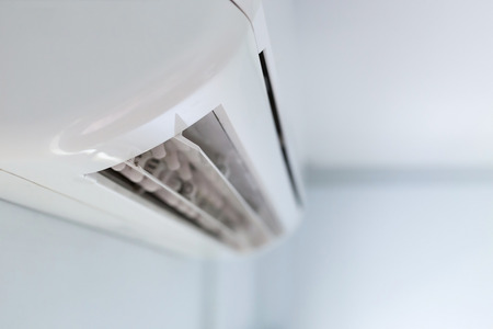cool air conditioner system on white wall room Foto de archivo