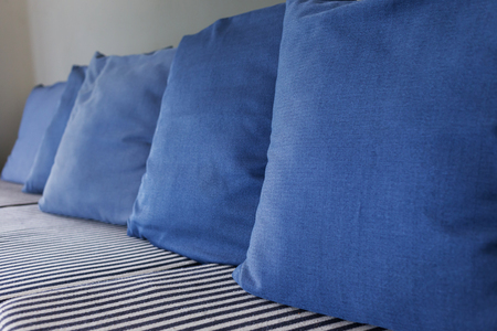 living room furniture: blue pillow on sofa furniture decorated in living room Stock Photo