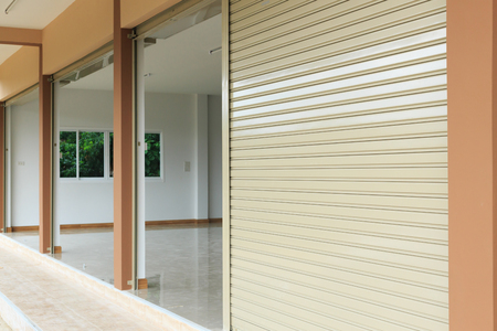 warehouse building: steel metal door, roller shutter door in warehouse building Stock Photo