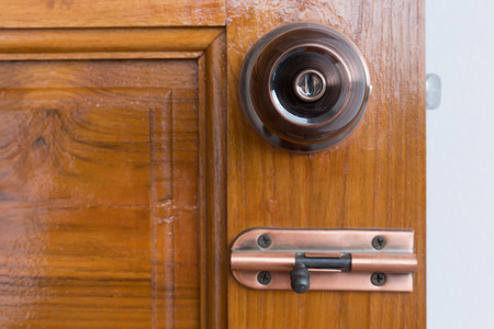hasp: door knob and keyhole on wooden door, close up image Stock Photo