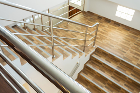 metallic stairs: staircase in residential house with stainless steel banister Stock Photo