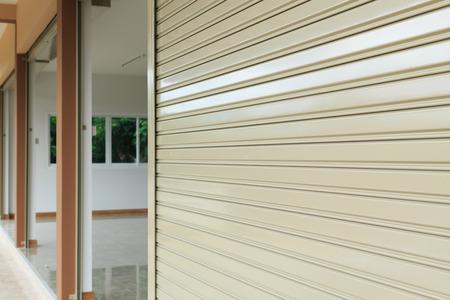 steel metal door, roller shutter door in warehouse building Foto de archivo