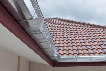 gutter roof residential building house in rainy day
