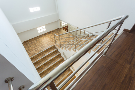 property ladder: staircase in residential house with stainless steel banister, ceramic floor tiles wood pattern