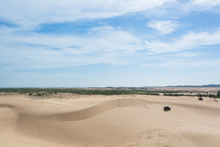 off road: off road car vehicle in white sand dune desert at Mui Ne, Vietnam