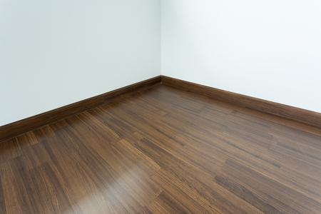 wood laminate: empty room interior, brown wood laminate floor and white mortar wall