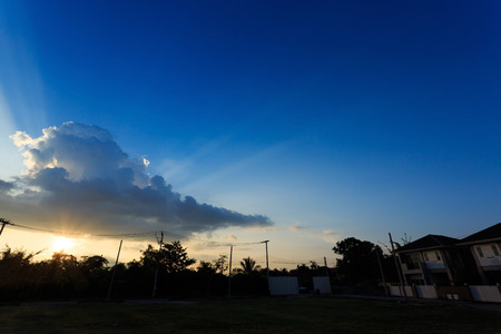 cloudy moody: beautiful sunset sky with sunlight through cloudy, dramatic moody sky background Stock Photo
