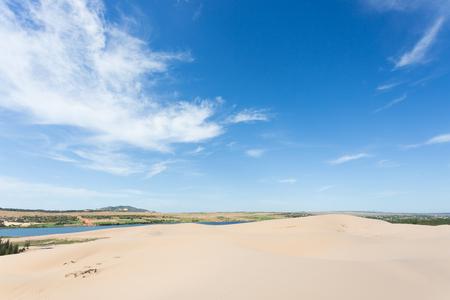 white sand dune desert and lake oasis in Mui Ne, Vietnam