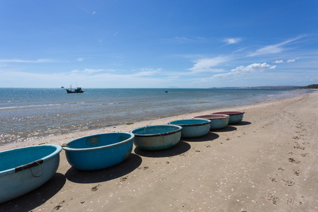 nautical fishing coracles on coast, tribal boats at fishing village in vietnam Stock Photo