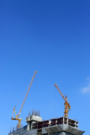reinforcement: machinery crane working in construction site building industry with blue sky background