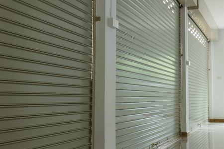 warehouse building: roller shutter door in warehouse building, aluminium steel metal door Stock Photo