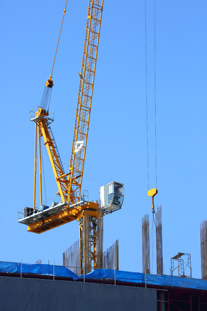 reinforcement: machinery crane working in construction site building Stock Photo