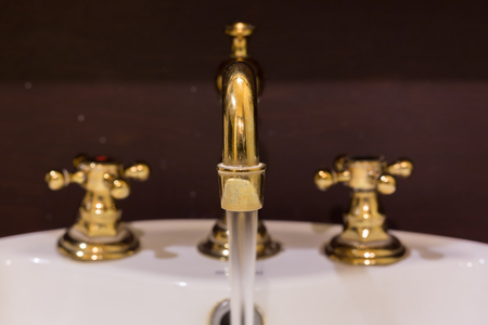 gold faucet and washbasin design retro vintage decorated luxury interior bathroom Stock Photo