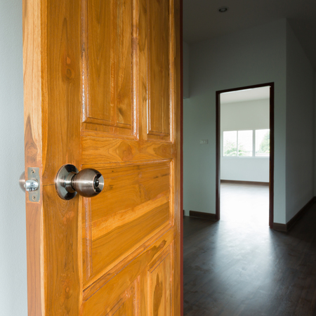 room door: open wooden door empty room in building residential house Stock Photo