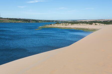 ne: white sand dune desert and lake in Mui Ne, Vietnam Stock Photo