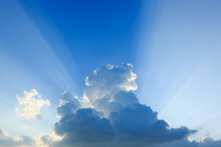 light rays explosion on clear blue sky with cloud Stock Photo