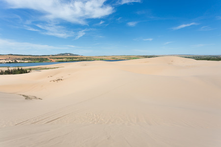 ne: white sand dune desert and lake oasis in Mui Ne, Vietnam