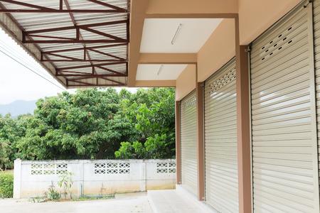 roller shutter door in warehouse building, aluminium steel metal door Banco de Imagens