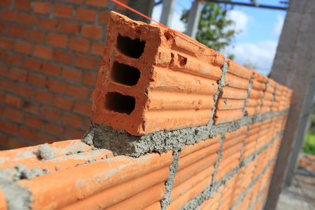 brick block structure construction plaster cement mortar wall in residential building industry Stock Photo