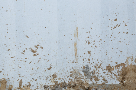white wall cement dirty with muddy splashing in construction site building industry