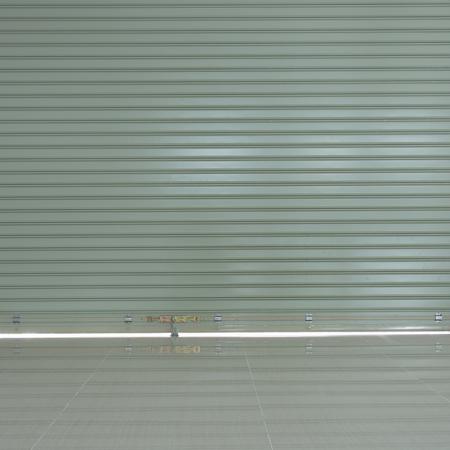 aluminium: Aluminium steel roller shutter door and tile floor in warehouse building