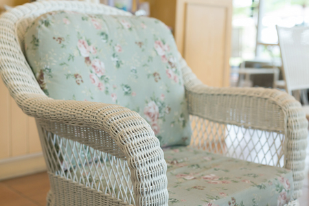 weave sofa with pillow cushion decoration in cafe